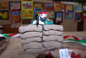 نمایشگاه هفته دفاع مقدس در همدان
