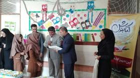 تجهیز کتابخانه دبستان حجت روستای افشاری