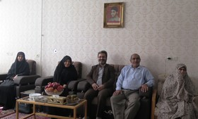 دیدار با خانواده شهید و گل افشانی مزار شهدا